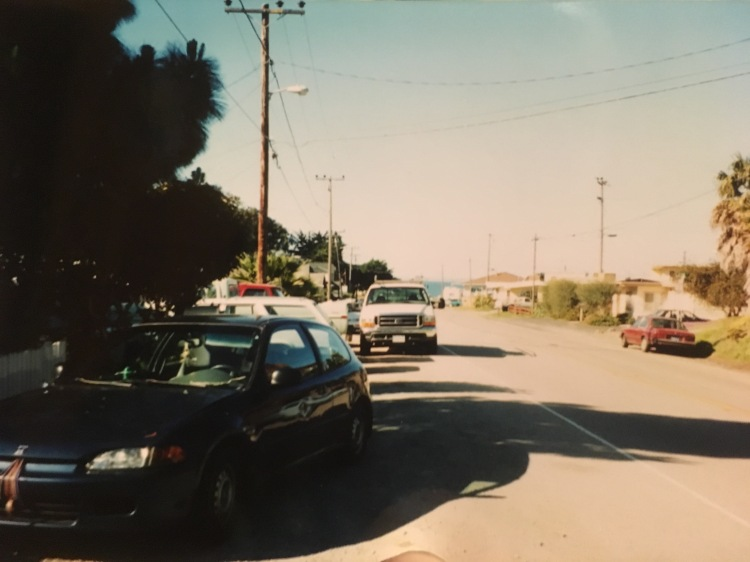 """And here is the """"postage stamp sized"""" view of the Pacific Ocean we enjoyed :-) That's our battered Honda Civic on the left."""